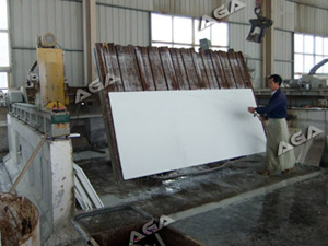 bridge saw cutting marble slab